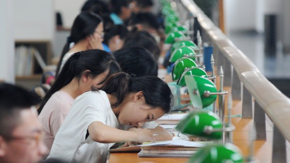 """Chinese students review textbooks or write test papers to prepare for the upcoming National College Entrance Exam, also known as gaokao, at the Shanxi Library in Taiyuan city, north China's Shanxi province, 2 June 2016.  Some nine million students are preparing for the biggest test of their life: China's annual college entrance examination. Called the gaokao, or """"high exam,"""" it will take place over nine hours on June 7-8 across China. It's the culmination of years of memorization and test taking, capped off by at least 12 months of grueling preparation. With its roots in the imperial examinations that started more than 2,000 years ago, the gaokao decides what school you go to and what career you might have, says Xiong Bingqi, vice president at the 21st Century Education Research Institute in Shanghai. The gaokao is an especially high hurdle for China's more than 100 million rural students, who already receive an education of far lower quality than their urban counterparts. A quota system for allocating coveted college slots by province, which greatly favors local students, also works against rural youth who often live far from the better universities and need higher test scores than local applicants to gain admission. That means urban youth are 7 times as likely to get into a college as poor rural youth and 11 times as likely to get into an elite institution, according to economist Scott Rozelle, a Chinese education researcher at Stanford. """"The current system itself is unfair,"""" Xiong says. """"Inequality is inevitable."""""""