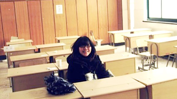Shen Lu revisits her old high school classroom in 2011, two years after taking the gaokao.