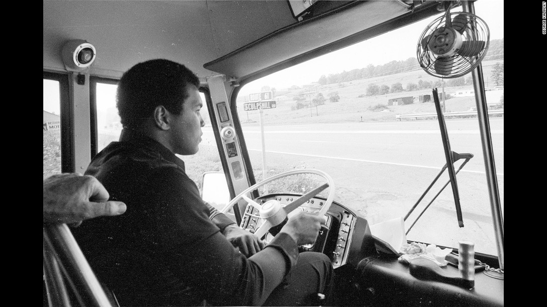 "Ali drives around a busload of reporters in 1976, before his third fight with Ken Norton. ""It was a publicity thing that Ali's driving the bus,"" Kalinsky said. ""Well, he drove the bus into a ditch. And I know he purposefully did that because he told me he was going to do it."""