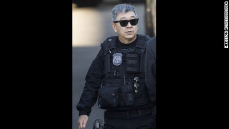 Brazilian Federal Police Officer Newton Ishii is accused of helping to bring contraband goods into Brazil.