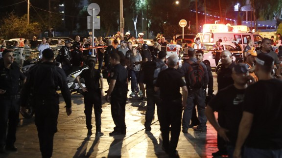 Israeli security forces, emergency personnel and civilians are seen at the site of a gun attack in the coastal city of Tel Aviv on June 8, 2016.  / AFP / JACK GUEZ        (Photo credit should read JACK GUEZ/AFP/Getty Images)