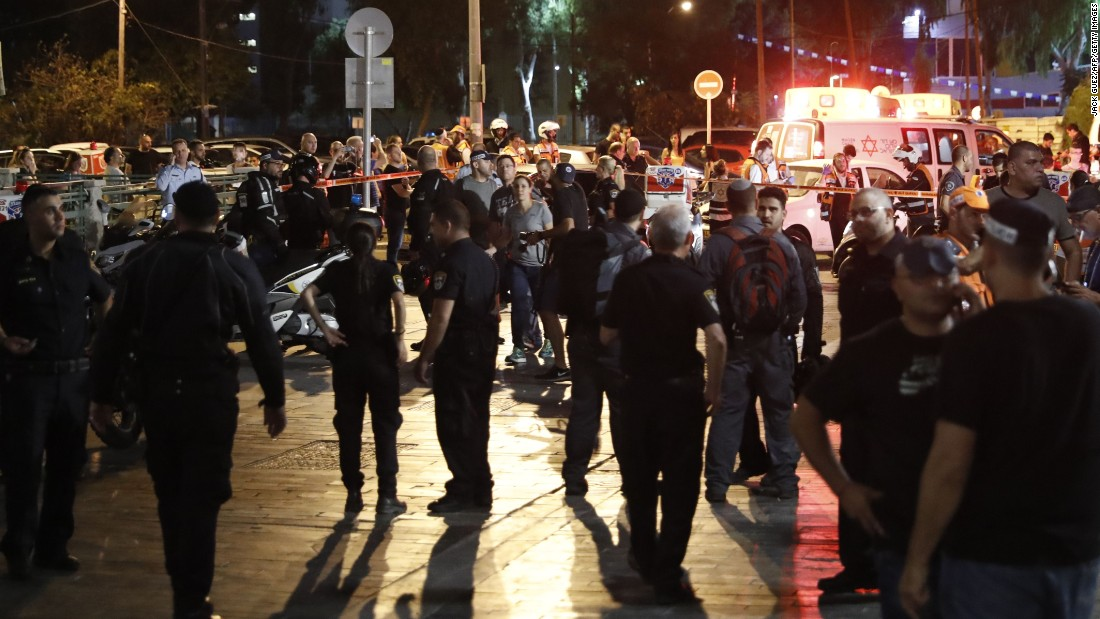 People gather at the site of an attack in Tel Aviv, Israel, on Wednesday, June 8. Several people were killed when terrorists opened fire at a popular market complex, Israeli authorities said.