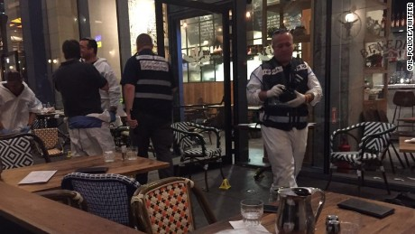 Police survey the scene of a terror attack in Tel Aviv.