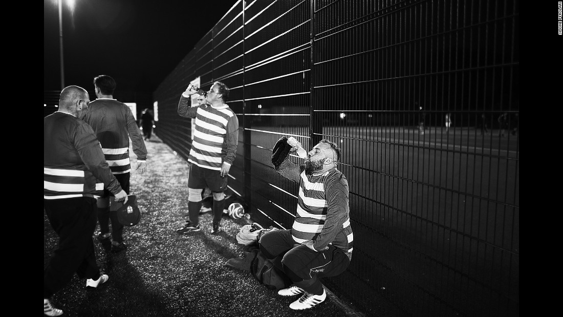 Players from Beer Bellies United hydrate during a match.