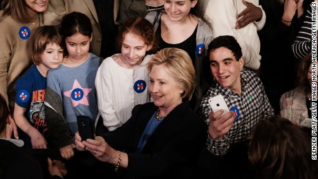 PURCHASE, NEW YORK - MARCH 31:  Democratic presidential candidate Hillary Clinton takes a selfie with supporters after speaking at SUNY Purchase on March 31, 2016 in Purchase, New York. Clinton gave a speech to both students and supporters that covered a host of domestic and international issues. New York will hold its primaries on April 19.  (Photo by Spencer Platt/Getty Images)