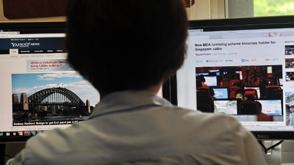 A person browses through media websites on a computer in Singapore on May 30, 2013.  Singapore's official media watchdog on May 30 refuted claims by online critics that a new rule requiring news websites to obtain licences was aimed at stifling Internet freedom.     AFP PHOTO/ROSLAN RAHMAN        (Photo credit should read ROSLAN RAHMAN/AFP/Getty Images)