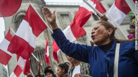 Suporters of Peru´s presidential candidate Pedro Pablo Kuczynski, protest in front of the National Office of Electoral Processes (ONPE)  in Lima on June 7, 2016 against a possible electoral fraud. Ex-Wall Street banker Pedro Pablo Kuczynski's camp claimed victory Tuesday in Peru's photo-finish presidential election, but polarizing rival Keiko Fujimori said it's not over till the last vote is counted. / AFP / ERNESTO BENAVIDES        (Photo credit should read ERNESTO BENAVIDES/AFP/Getty Images)