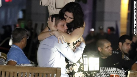 Israelis embrace following a shooting attack at a shopping complex in the Mediterranean coastal city of Tel Aviv on June 8, 2016.