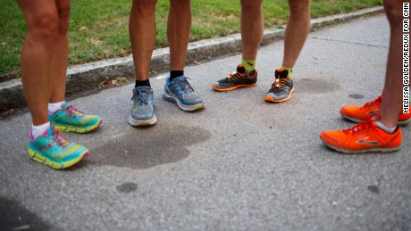 With their brightly colored running shoes, Icebreakers and guest runners go over a tricky part of the route before hitting the road in Atlanta.