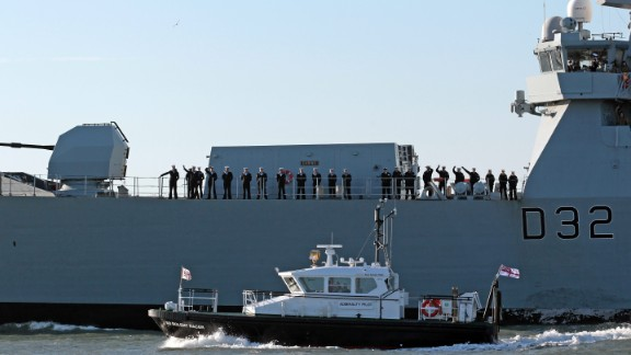 Crew aboard HMS Daring, the largest and most powerful destroyer warship ever built for the Royal Navy, leaves Portsmouth Harbour on January 11, 2012 in Portsmouth, England.