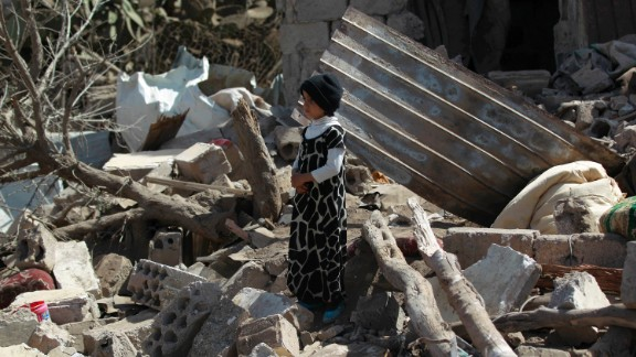Boy stands in rubble after airstrikes in Sanaa earlier this year.