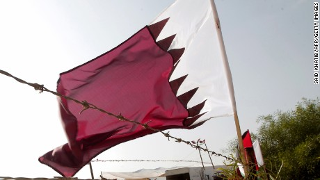 A Qatari flag flutters at the construction site of a residential project funded by Qatar in Khan Yunis in the southern Gaza Strip on October 22, 2012.