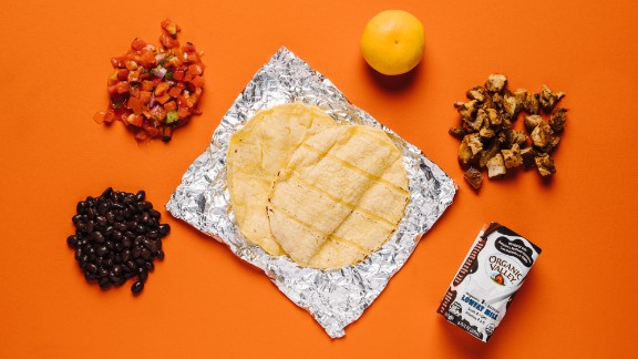 Here is one the best kid options if you're focused on healthy choices within the limits of the menu. Chipotle's tacos with chicken, black beans and tomato salsa off the kids' menu, plus a Mandarin orange and organic milk, are a healthier option than a quesadilla, with added boosts in calcium and vitamin C.