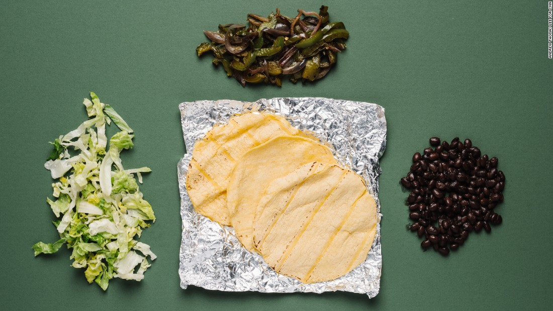 For vegans, tacos with black beans, fajita vegetables and romaine lettuce are a healthy option. Plus, you save on saturated fat by skipping the cheese.
