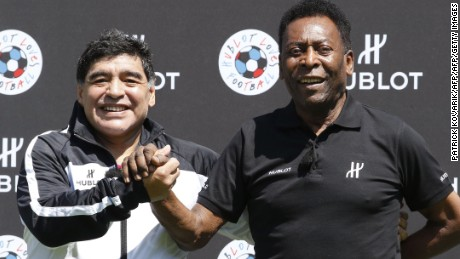 Former Argentinian football international Diego Maradona (L) and former Brazilian footballer Pele pose after a football match organised by Swiss luxury watchmaker Hublot at the Jardin du Palais Royal in Paris on June 9, 2016, on the eve of the Euro 2016 European football championships. / AFP / PATRICK KOVARIK        (Photo credit should read PATRICK KOVARIK/AFP/Getty Images)
