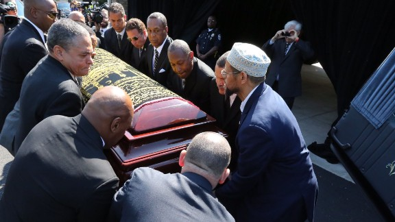 Pallbearers place Ali's casket in a hearse before the procession began.