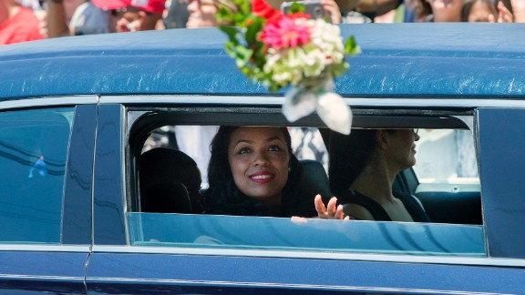 Ali's daughter Hana throws flowers as the procession enters the cemetery.