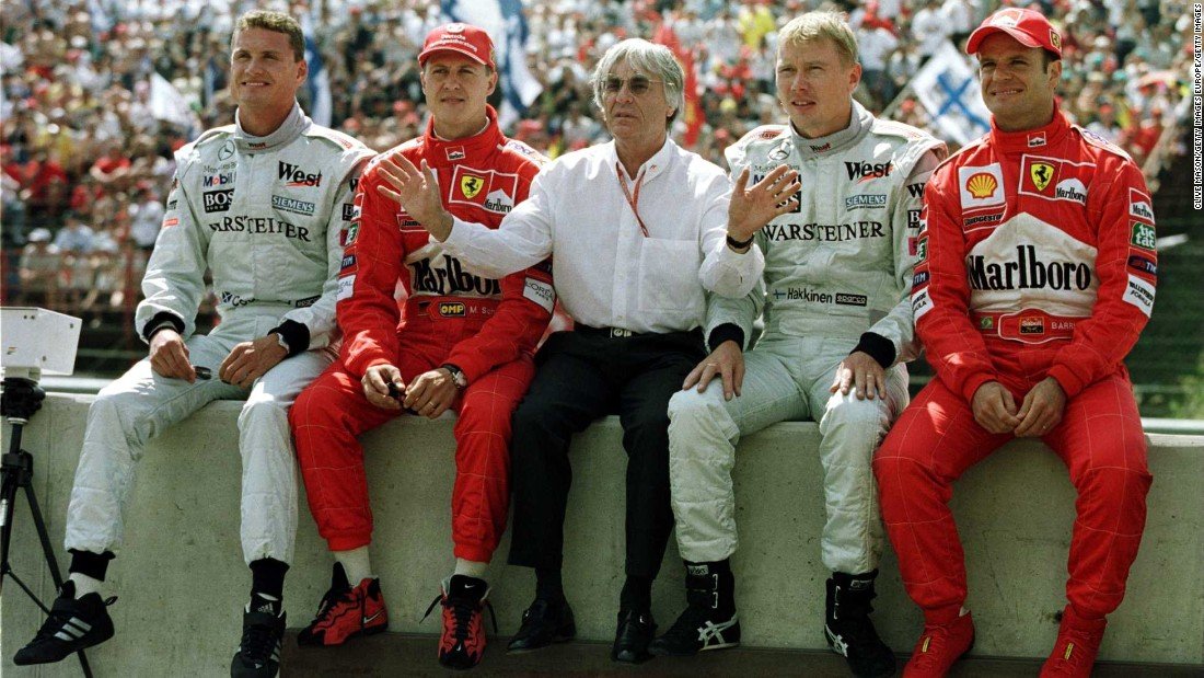 Ecclestone posing with (from L-R) David Coulthard, Michael Schumacher, Mika Hakkinen and Rubens Barrichello at the Hungarian Grand Prix in 2000. Today, the 85-year-old Briton shows no sign of slowing down.