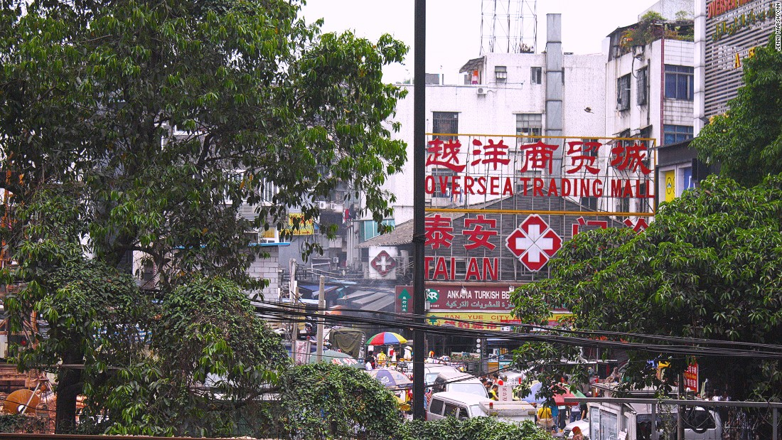 The Overseas Trading Mall sign dominated the skyline of Dengfeng village, in 2014.
