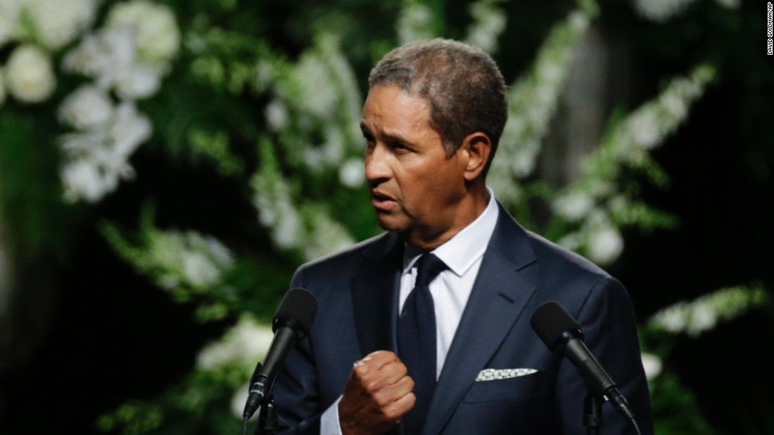 "Sportscaster Bryant Gumbel said he was honored to speak at Ali's service, saying ""to be standing here by his and Lonnie's request is mind-numbing. God bless you, Champ."""