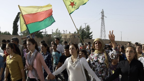 Syrian Kurds march at the funeral of fighters who died fighting ISIS in Manbij.