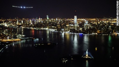 Solar Impulse 2 flies above New York City and the Statue of Liberty.