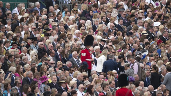 Soldiers direct guests to their seats to watch the traditional Trooping the Color in London on Saturday, June 11. The Queen continues to celebrate her 90th birthday with the display of more than 1,400 officers and men in their famous red jackets and black bearskin hats, with 200 horses and more than 400 musicians.