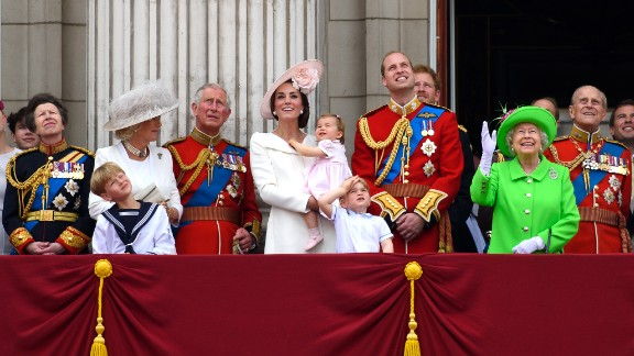 From left to right:  Anne, Princess Royal; Camilla, Duchess of Cornwall; Charles, Prince of Wales; Catherine, Duchess of Cambridge, Princess Charlotte of Cambridge; Prince George of Cambridge; Prince William, Duke of Cambridge; Prince Harry, Queen Elizabeth II and Prince Philip, Duke of Edinburgh, gather on a balcony to watch the events.