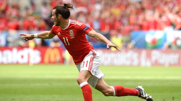 Wales forward Gareth Bale celebrates after scoring the match's first goal.