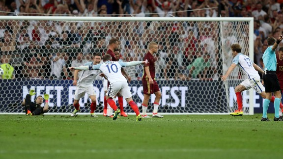 England midfielder Eric Dier, third right,  celebrates after scoring the match's first goal.