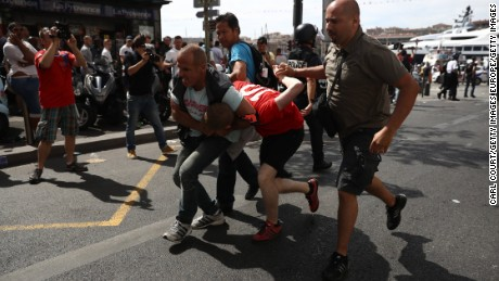 Fans skirmish ahead of the match in the French port city of Marseille on Saturday.