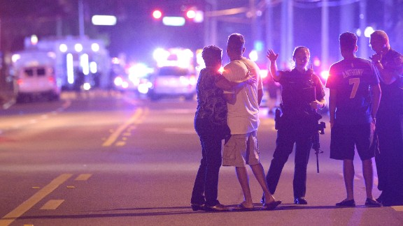 Police direct family members away from the scene of a shooting at the Pulse nightclub in Orlando in June 2016. Omar Mateen, 29, opened fire inside the club, killing at least 49 people and injuring more than 50. Police fatally shot Mateen during an operation to free hostages that officials say he was holding at the club.
