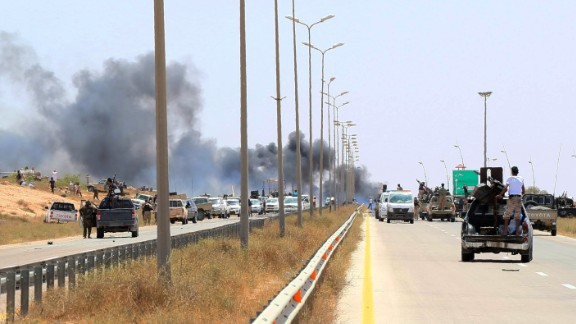 Smoke billows at the entrance of Sirte as forces loyal to Libya