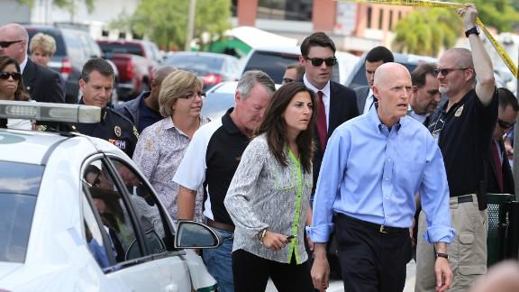 Florida Gov. Rick Scott arrives at the scene.
