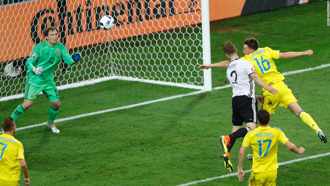Germany's Shkodran Mustafi heads in the opening goal against Ukraine during a Euro 2016 match in Lille, France, on Sunday, June 12. Bastian Schweinsteiger added a late goal to cap off a 2-0 victory.