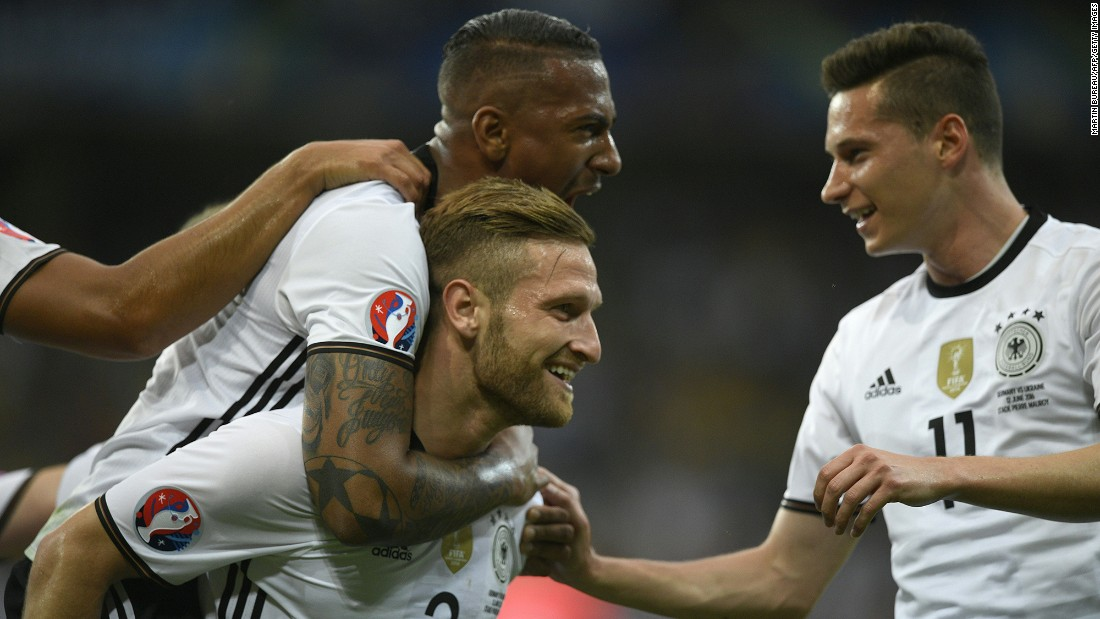 Mustafi celebrates with teammates Jerome Boateng, top, and Julian Draxler, right.