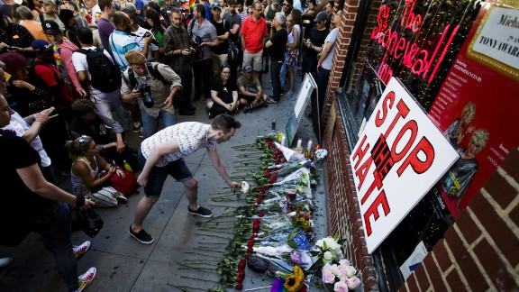 People gather for a vigil June 12 outside the Stonewall Inn in New York. Stonewall is considered the birthplace of the gay rights movement.