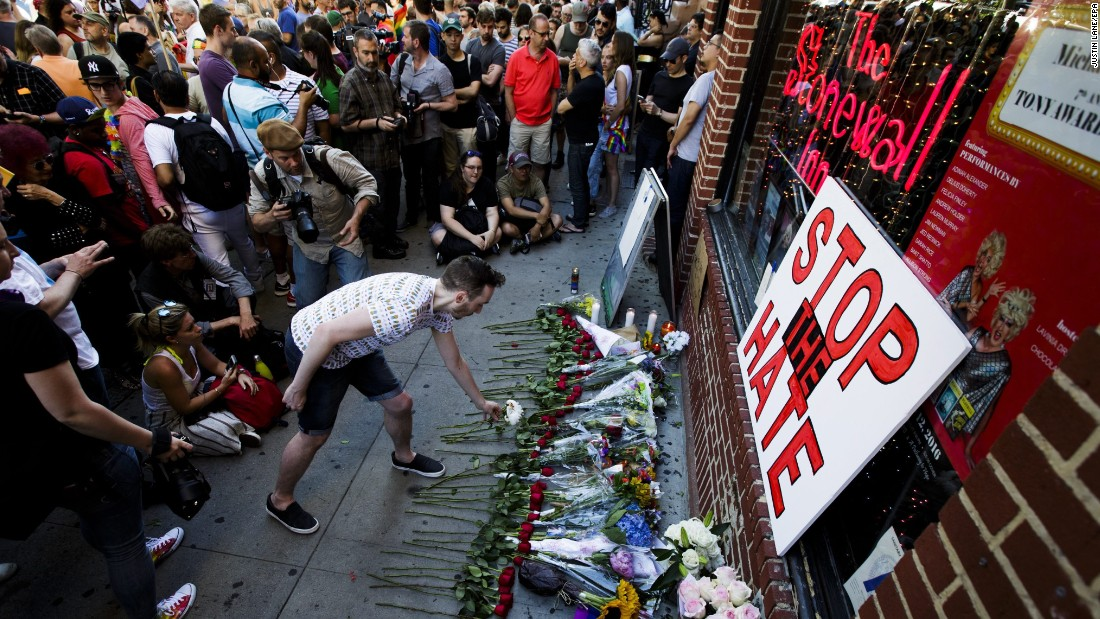 "People gather for a vigil June 12 outside the Stonewall Inn in New York. <a href=""http://www.cnn.com/2016/05/09/travel/stonewall-inn-nps-national-monument-gay-rights/index.html"" target=""_blank"">Stonewall</a> is considered the birthplace of the gay rights movement."