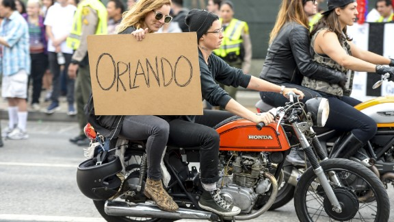 People show their support for Orlando during the Los Angeles gay pride parade.