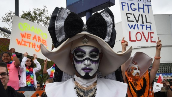 Participants in the Los Angeles gay pride parade show their support for the victims on June 12.