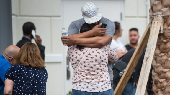 Friends and family react after a list of hospitalized victims is released June 12 outside a hotel near the Orlando Regional Medical Center.
