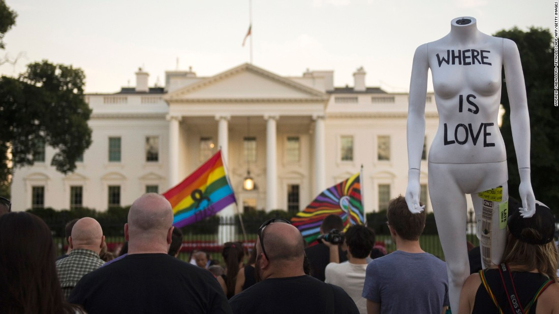 "Mourners gather during a vigil in front of the White House on June 12. President Barack Obama called the mass shooting an ""act of terror"" in remarks to the nation."