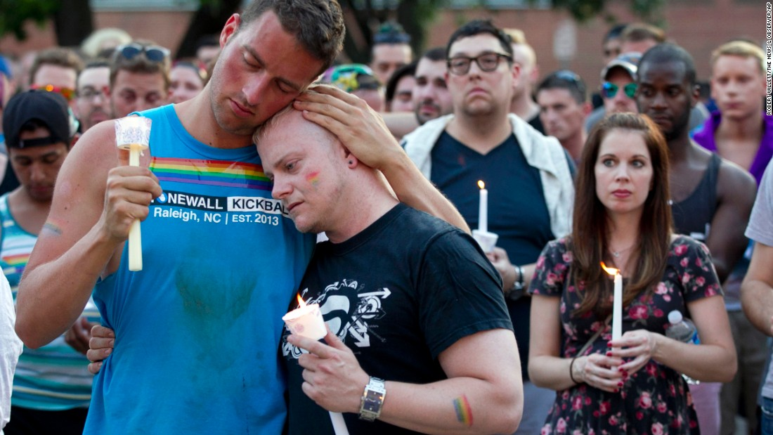 Ryan Gibson, left, embraces Tabor Winstead during a vigil in Raleigh, North Carolina, on June 12.