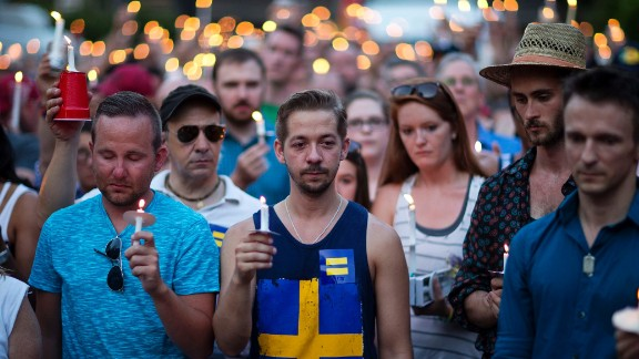 Mourners observe a moment of silence during a vigil in Atlanta.