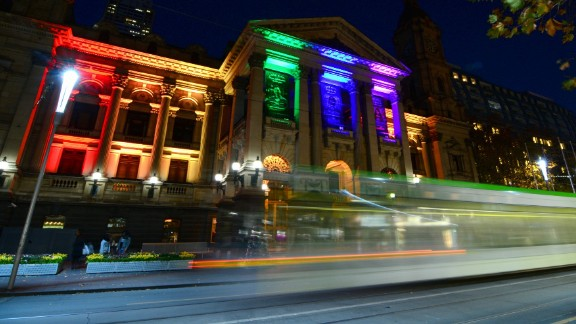 """The city of Melbourne posted this image on its Twitter account June 13 """"as a mark of respect for those touched by the attack in Orlando. Town Hall is lit in the rainbow #LoveIsLove."""""""