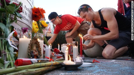 Mourners pay tribute to the victims of the Orlando shooting during a memorial service in San Diego, California in San Diego, California on June 12, 2016. Fifty people died when a gunman allegedly inspired by the Islamic State group opened fire inside a gay nightclub in Florida, in the worst terror attack on US soil since September 11, 2001.