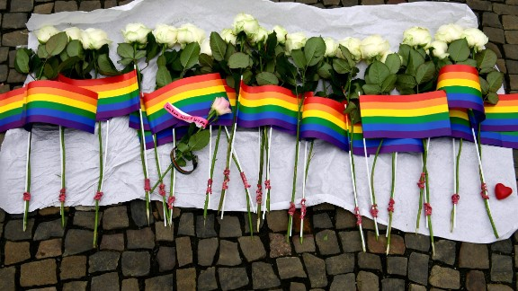White roses and rainbow flags are displayed in front of the US Embassy in Berlin on June 13, 2016 as people pay tribute to the victims of the Orlando killing. Fifty people died when a gunman allegedly inspired by the Islamic State group opened fire inside a gay nightclub in Florida, in the worst terror attack on US soil since September 11, 2001. / AFP / John MACDOUGALL        (Photo credit should read JOHN MACDOUGALL/AFP/Getty Images)