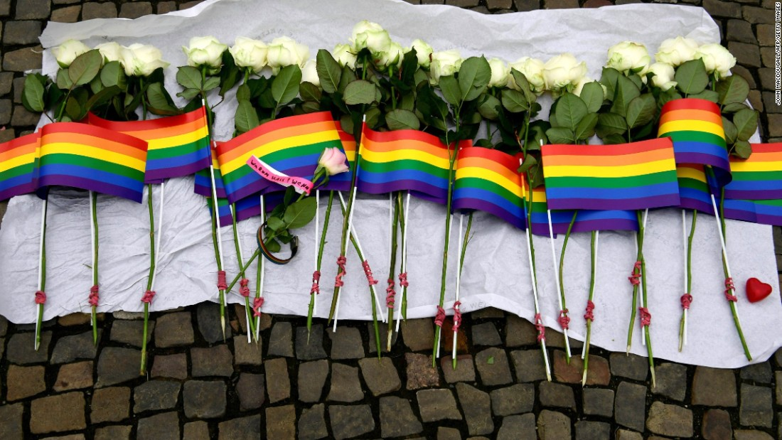White roses and rainbow flags are displayed in front of the U.S. Embassy in Berlin on June 13.