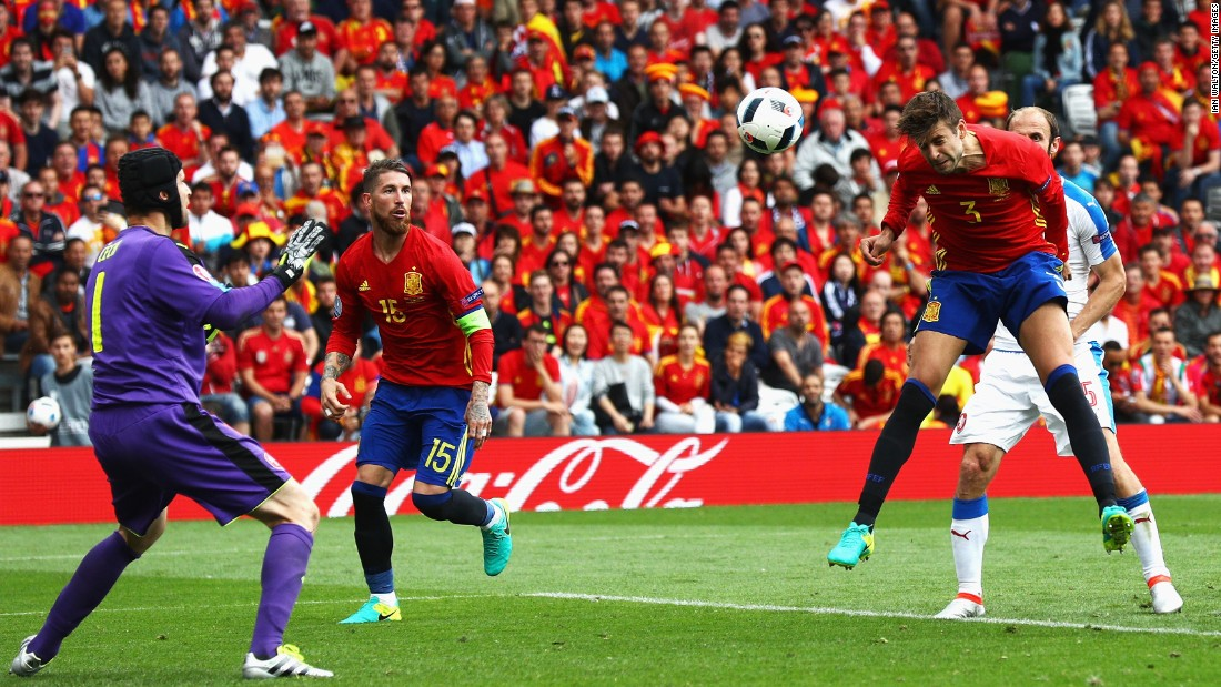 Spanish defender Gerard Pique heads the ball past Czech goalkeeper Petr Cech for the only goal of their Euro 2016 opener. Spain has won the last two Euro tournaments.