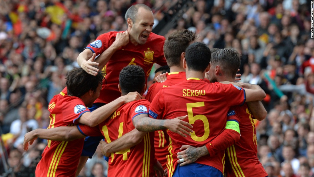 Spanish players celebrate after Pique's goal, which came late in the match in the 87th minute.